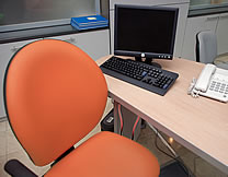 orange office chair and workstation
